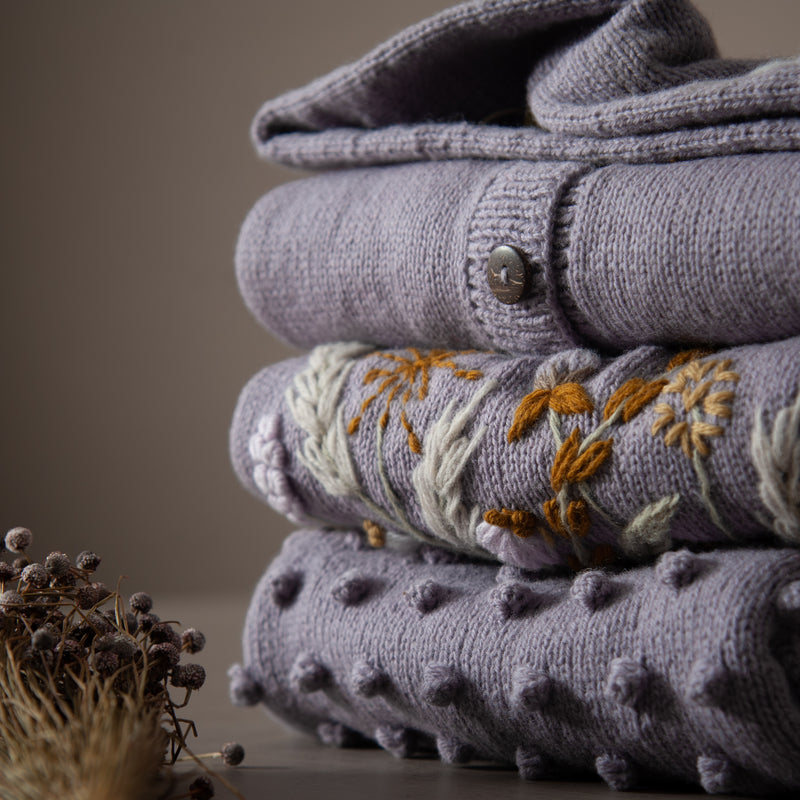 stack of lavender knits for kids and baby