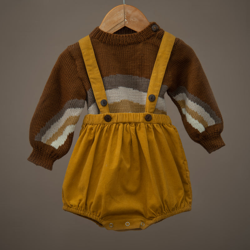 mustard corduroy suspender shorts for kids paired with caramel rainbow knitted sweater