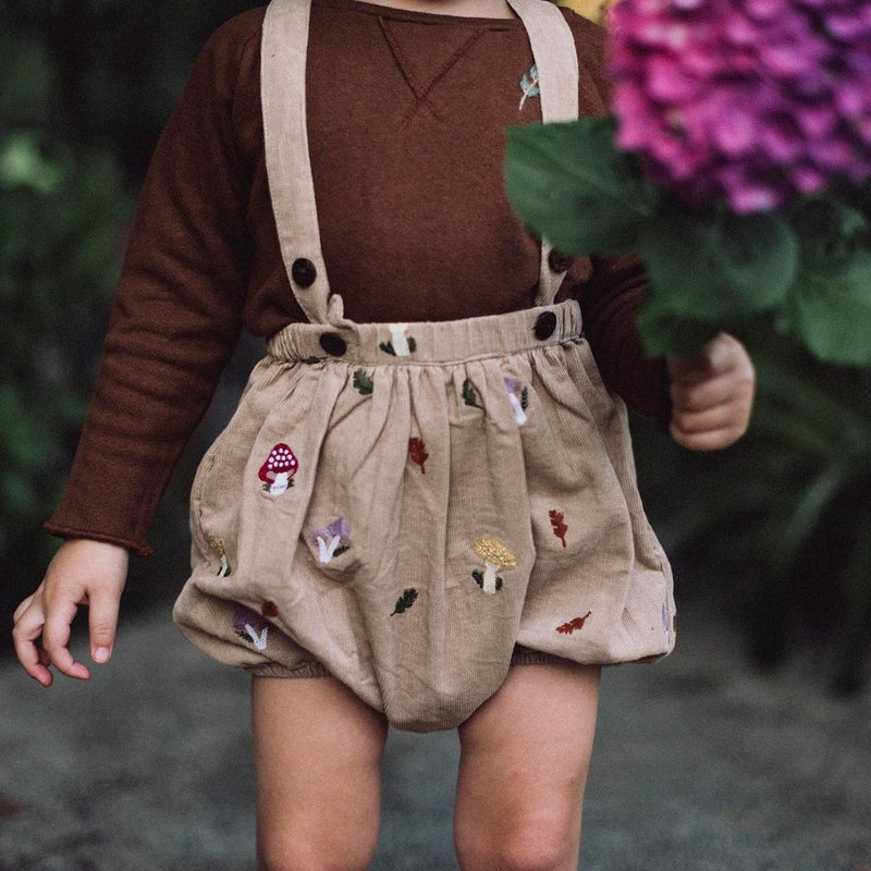 little boy in corduroy embroidered oats suspender shorts and brown hemp cotton sweatshirt