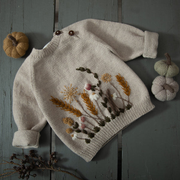 hand knitted nude sweater with hand embroidered wildflowers