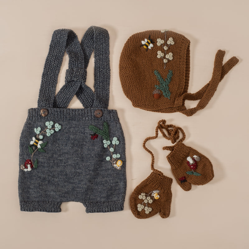 flat lay picture of woodland bonnet caramel along with other woodland range outfits