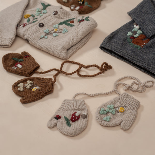 flatlay picture of woodland mittens oats along with other woodland range outfits