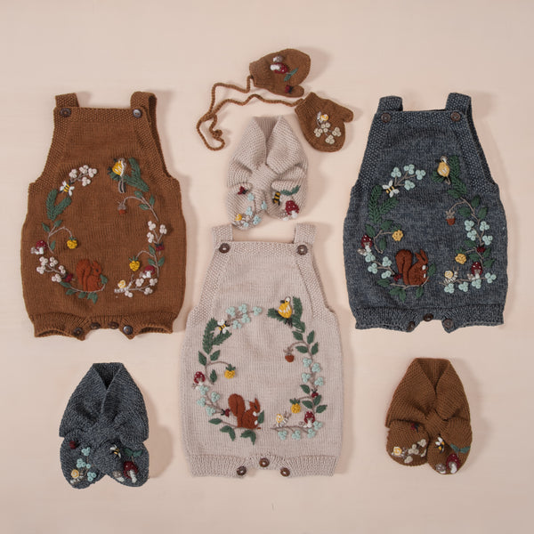 flat lay picture of woodland romper caramel alonf with other woodland outfits
