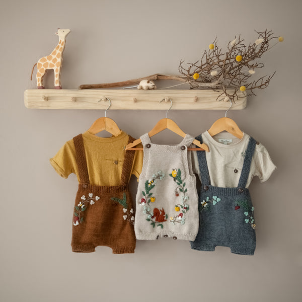 woodland suspender shorts caramel with hemp cotton t-short masala hanged in coat rack along with other woodland range outfits