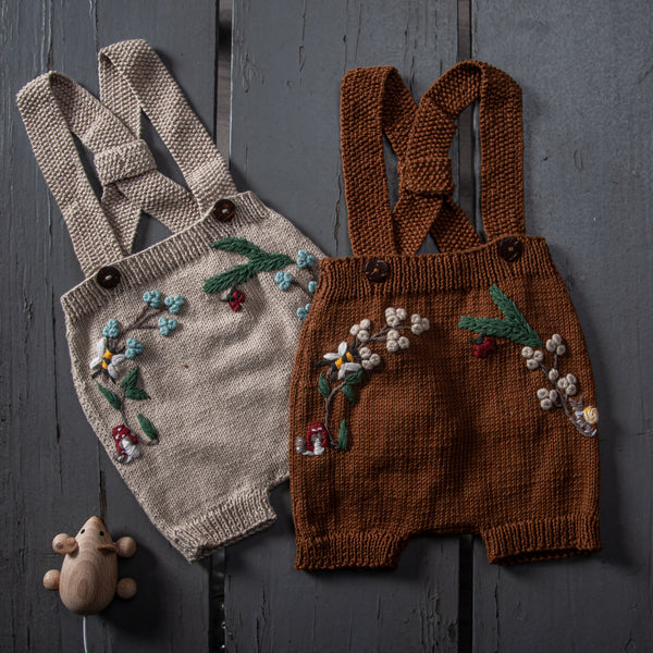 flat lay picture of woodland suspender shorts oats and caramel in cotton yarn