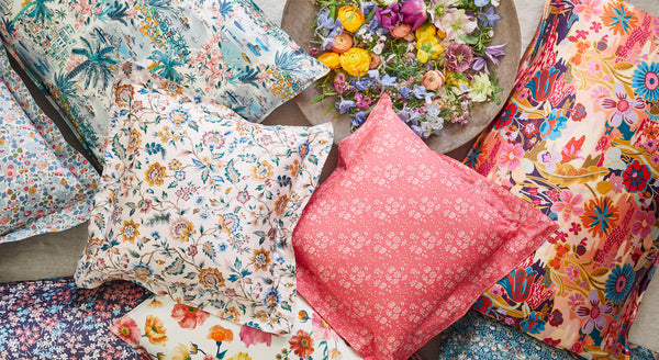 Coco & Wolf's new collection, The Imagining, with Liberty fabric cushions.