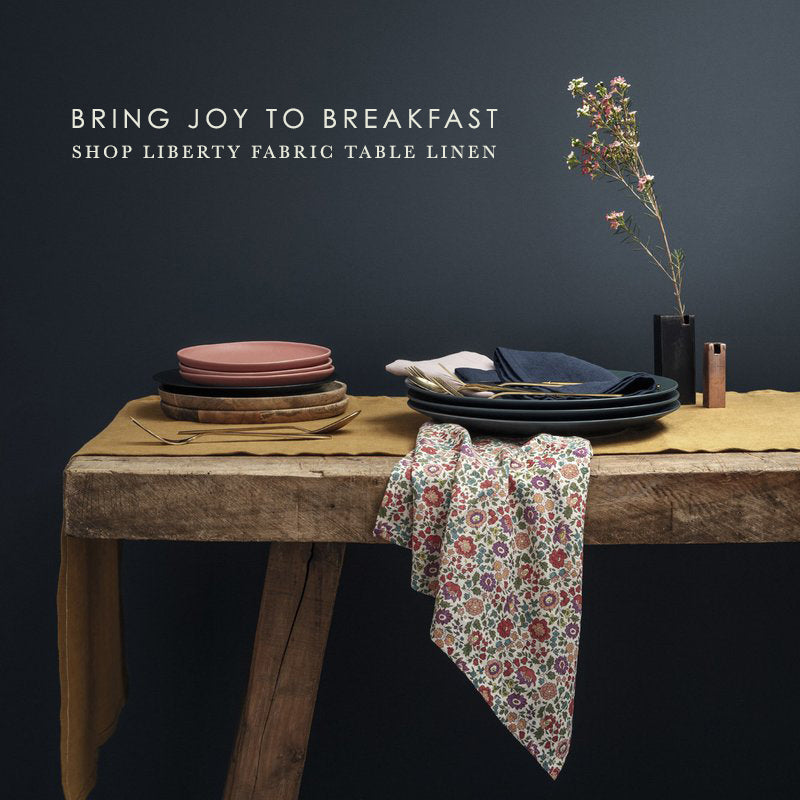 Bring joy to breakfast with Coco & Wolf's Liberty fabric table linen.