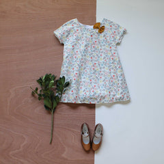 Liberty print Brae dress in edenham with rust hair bow