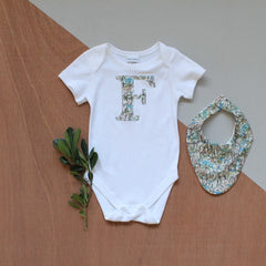 Liberty print personalised bodysuit in rumble and roar