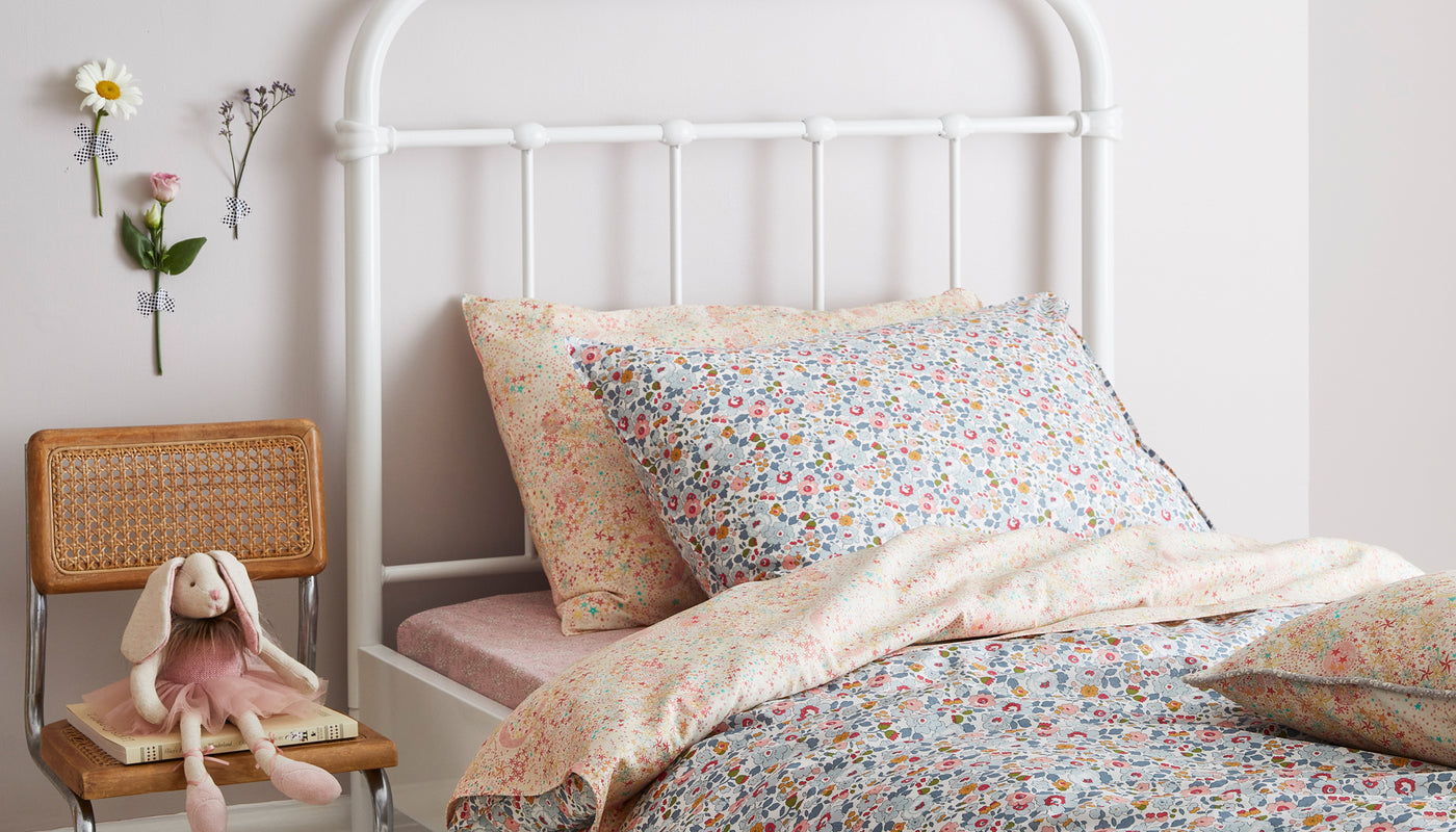 coco and wolf bedding made with liberty fabric in betsy grey and adelejda