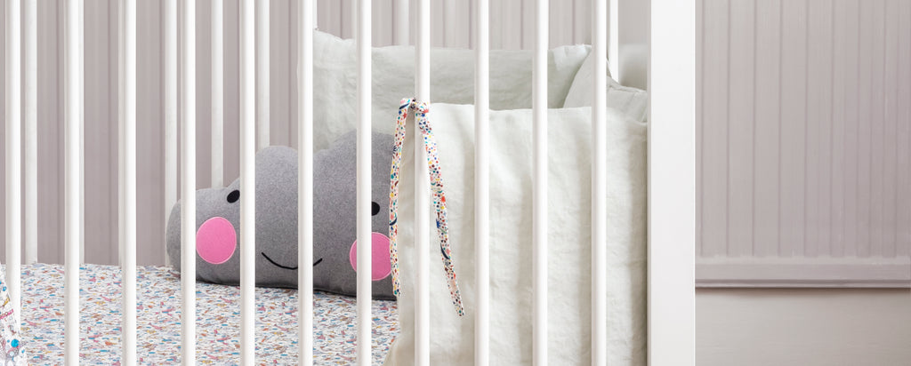 cot bumpers made with liberty fabric coco and wolf