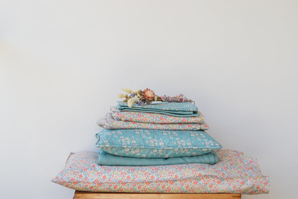 Stack of Liberty fabric products by Coco & Wolf