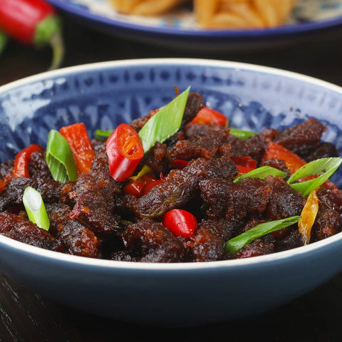 Bowl of fried beef strips with red chili