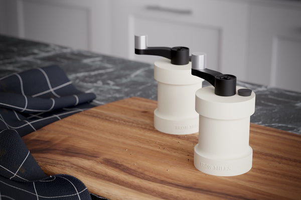 Salt & Pepper Mills Displayed on A Chopping Board With A Marble Worktop - In Oyster White