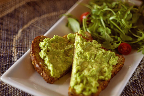 Plate of avocado toast and salad