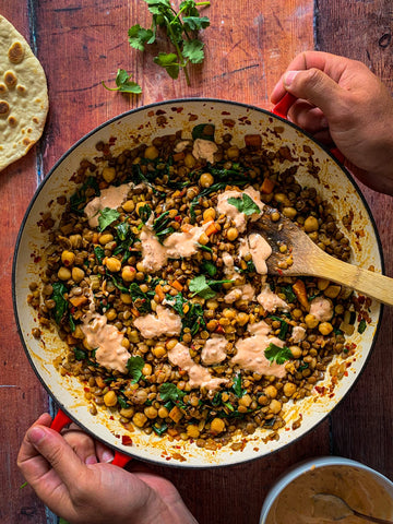 Bowl of lentil and chickpea stew with yoghurt topping