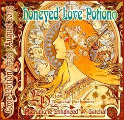 Love Potion perfume label featuring honey-colored Alphonse Mucha artwork of woman's face in profile.