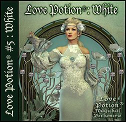 Love Potion: White perfume label featuring art nouveau style artwork of lovely woman in white surrounded by white flowers on pale green background.