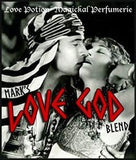 Love Potion pheromone label for Love God, featuring antique photo of silent film actor Valentino kissing a lover.