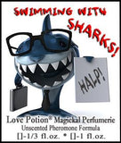 Love Potion: Swimming with Sharks pheromone label featuring a funny shark dressed for the office, wearing glasses and holding a briefcase and a sign that says, HELP!