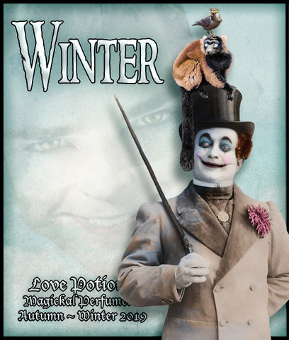 Love Potion: Winter label, featuring creepy looking carnival barker with a monkey and a bird on his top hat, on a background of wintery white clouds with a face in them.