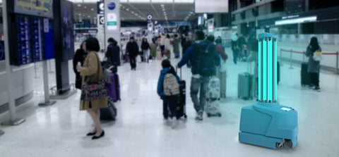 UVGI or UV light or UVC lamp in an airport around people sanitizing the airport