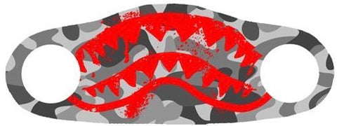 Red shark teeth printed on a face mask with a grey background