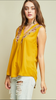 Mustard Sleeveless v-neck top featuring embroidery details at neckline.