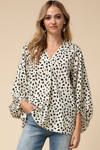 Cream/Black Geometric Print V-neck Top featuring bubble sleeve