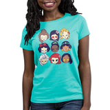 Disney Princess Emojis Women's T-Shirt Model Disney TeeTurtle blue t-shirt featuring a variety of Disney princesses including belle, mulan, rapunzel, snow white, tiana, jasmine, elsa, ariel and pocahontas
