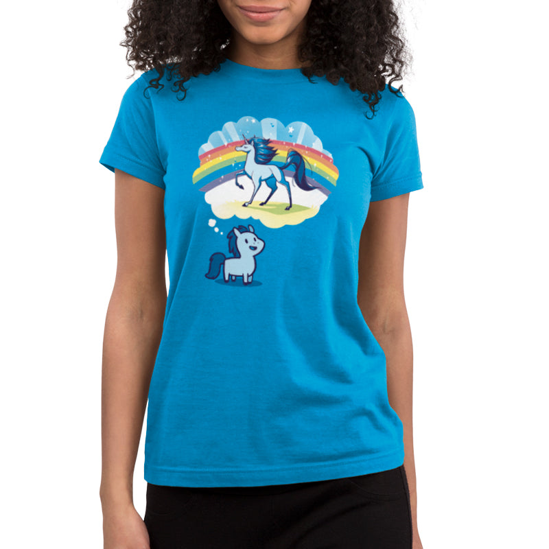 Dream Big, Little Horsey Juniors T-Shirt ModelTeeTurtle blue t-shirt featuring a pony with a thought bubble over its head and in the thought bubble is a majestic horse with a rainbow behind it
