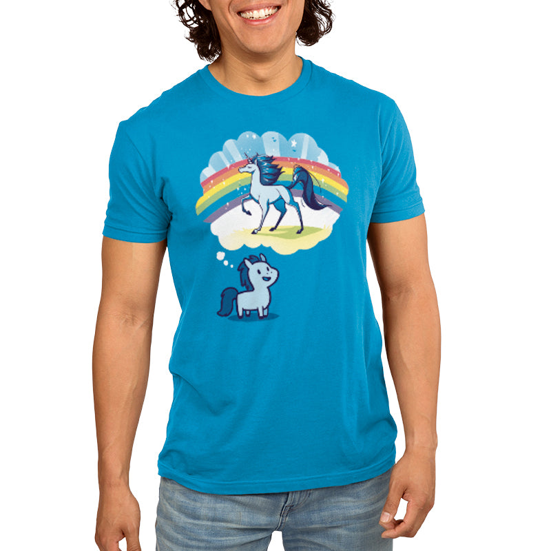 Dream Big, Little Horsey Men's T-Shirt ModelTeeTurtle blue t-shirt featuring a pony with a thought bubble over its head and in the thought bubble is a majestic horse with a rainbow behind it