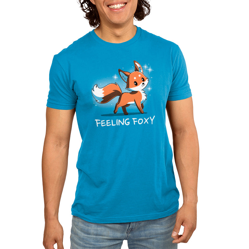 "Feeling Foxy Men's T-Shirt model TeeTurtle Blue t-shirt with a red orange fox with sparkles around him and shirt text ""feeling foxy"""