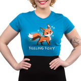 "Feeling Foxy Women's T-Shirt model TeeTurtle Blue t-shirt with a red orange fox with sparkles around him and shirt text ""feeling foxy"""
