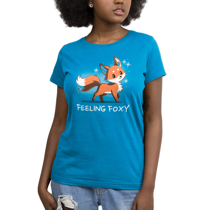 "Feeling Foxy Juniors T-Shirt model TeeTurtle Blue t-shirt with a red orange fox with sparkles around him and shirt text ""feeling foxy"""