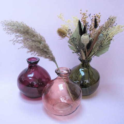Recycled glass vases and dried flowers at Pampas Living