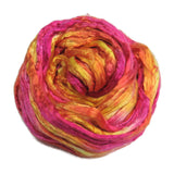 Mulberry Silk varigated roving, hand dyed in tones of magenta yellow.  Color: Sorbet