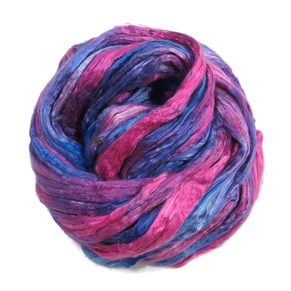 Mulberry Silk varigated roving, hand dyed in tones of magenta and blue.  Color: Garden of Roses