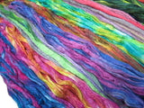 Mulberry Silk varigated roving, hand dyed in light tones of pastels.  Color: Russian Pink