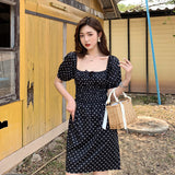 robe a pois noir decollete