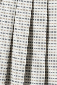 Gingham pleated a line midi skirt with bow ties pleats close up