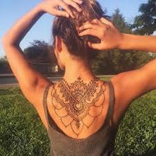 eagle spider tattoo back women