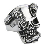 silver color serpent surrounding a skull head ring