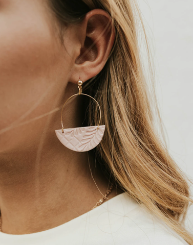 Try a pair of bold earrings to make a statement with your back to school outfit. www.loveoliveco.com