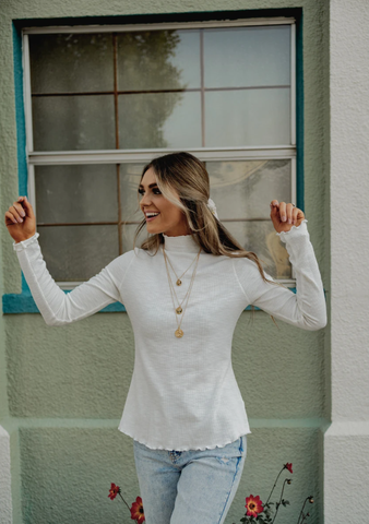 white thin turtleneck for the fall and winter. www.loveoliveco.com
