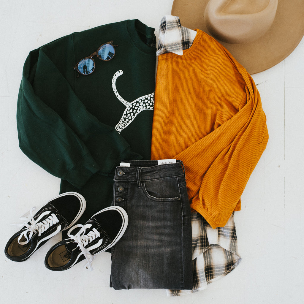 Wear your plaid and flannel tops with black distressed jeans