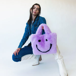 purple smiley cowgirl clutch