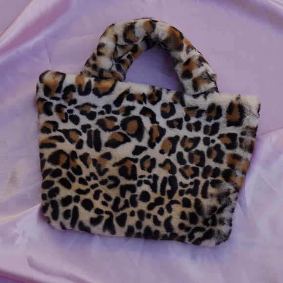 jaguar cowgirl clutch