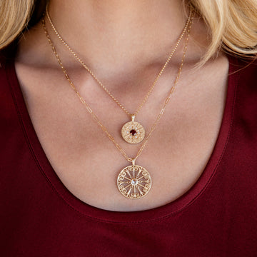 model wearing medallion necklaces