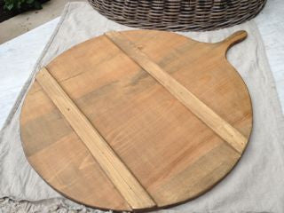 French round wooden cheese serving board